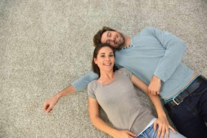 Couple laying on Carpeted Floor